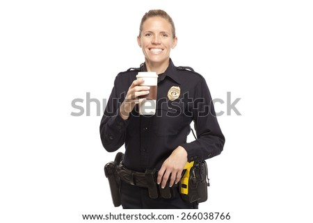 Happy female police officer with disposable coffee cup - stock photo