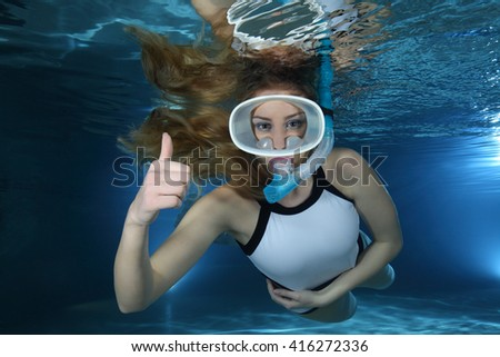 Happy female snorkeler show underwater hand signal