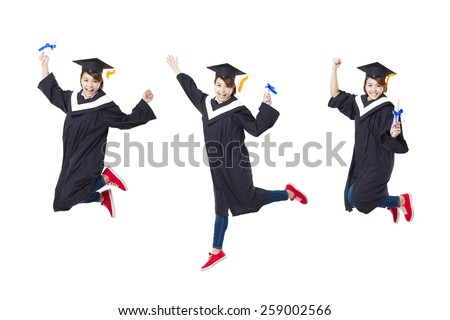 Happy female student in graduate robe jumping against white background - stock photo