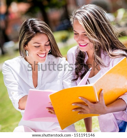 Happy female students at the university smiling
