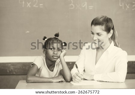 Happy female teacher comforting sad afroamerican schoolgirl. - stock photo