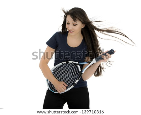 Happy female tennis player playing on racket as on guitar - stock photo