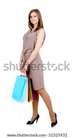 Happy female with bags looking at camera and smiling