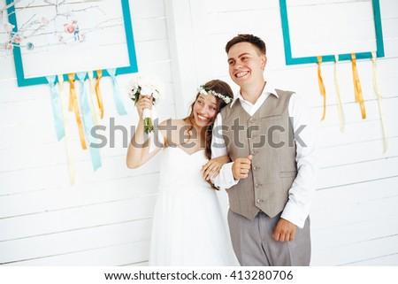 Happy Festive Wedding Couple Laughing. Selective Focus. - stock photo