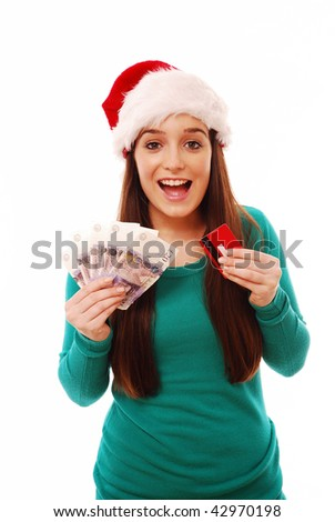 Happy festive woman holding credit card and money on white isolated background - stock photo