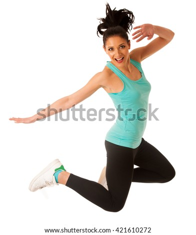 Happy fit and slim woman dancing and jumping isolated over white background
