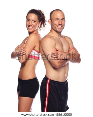 Happy, Fit couple standing back to back - stock photo