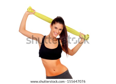 Happy fitness girl with green towel isolated on a white background - stock photo