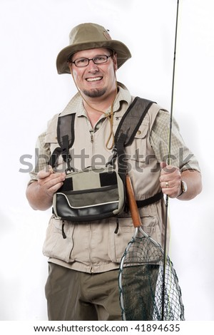 Happy fly fisherman with all his tackle - stock photo