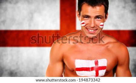 Happy football fan against england national flag - stock photo
