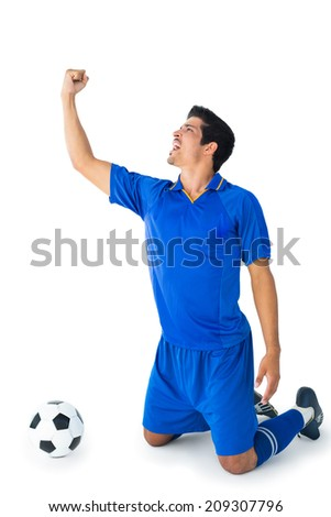 Happy football player in blue celebrating on white background