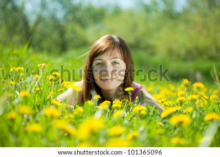 Happy  freckle woman relaxing in   park - stock photo