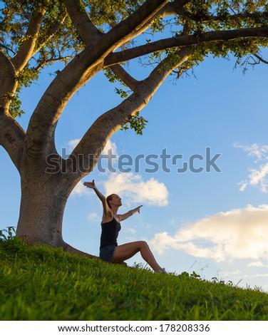 Happy free woman enjoying nature. Beauty girl outdoor. Freedom concept. Sunbeams. Enjoyment. - stock photo