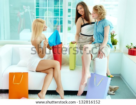 Happy friends boasting of their purchases - stock photo