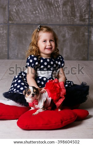 Happy friends child girl and dog at home - stock photo