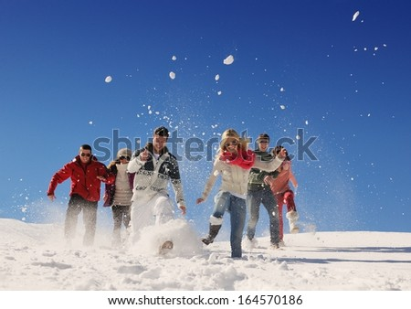 happy friends group  have fun at winter on fresh snow, healthy young people outdoor - stock photo