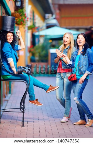 happy friends having fun in the old city street - stock photo
