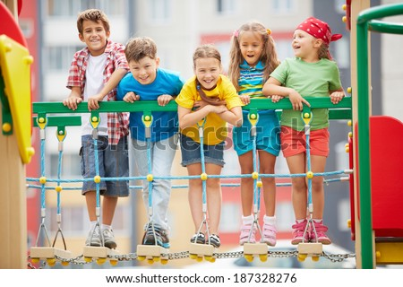 Happy friends having fun on playground - stock photo