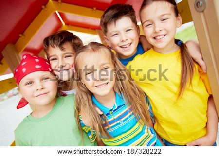 Happy friends looking at camera with smiles outdoors  - stock photo