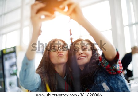 Happy friends making faces and posing for taking self pictures, enjoying themselves. - stock photo