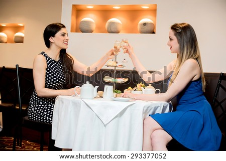 Happy friends of two at hotel having drinks - stock photo