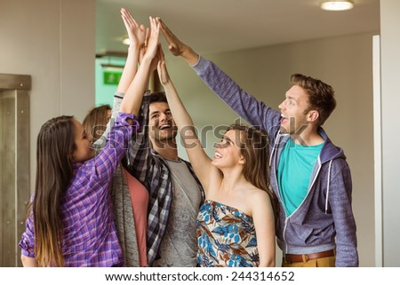 Happy friends students high five for their teamwork at school - stock photo