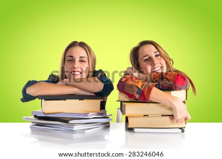Happy friends studying together