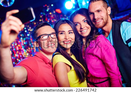 Happy friends taking selfie at party - stock photo