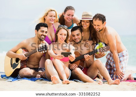 Happy friends together doing selfie at sea shore