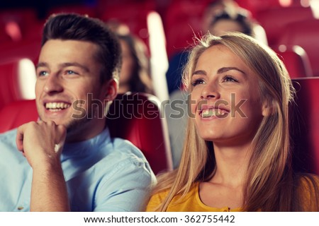 happy friends watching movie in theater - stock photo