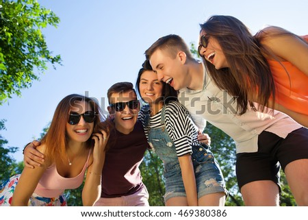 Happy friendship concept with young people having fun together
