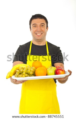 Happy fruiterer offering fresh fruits isolated on white background - stock photo