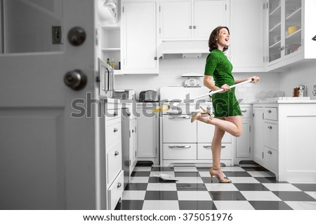 Happy fun dancing housewife housekeeping kitchen clean immaculate joyful pleasant lifestyle - stock photo