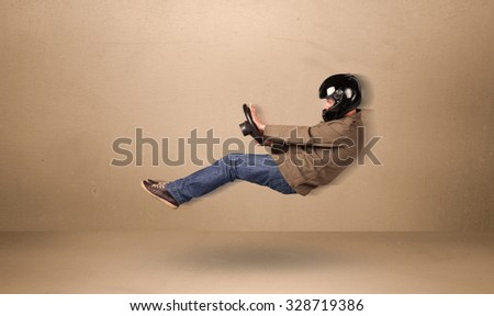 Happy funny man driving a flying car concept on background - stock photo