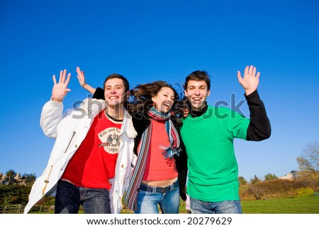 Happy funny team jumping - stock photo