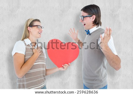 Happy geeky hipster and her boyfriend against white background - stock photo