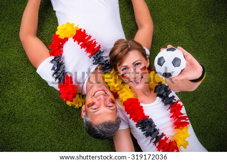happy german fans with ball  - stock photo
