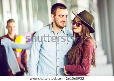 Happy girl and boy teenagers standing outside - stock photo