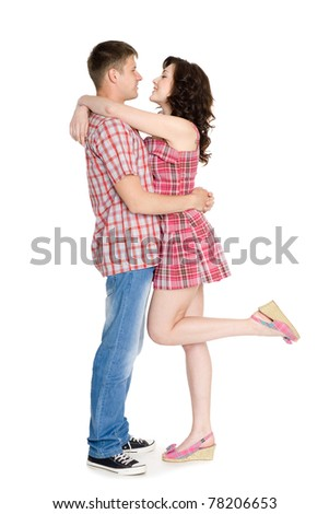 Happy girl and guy hugging each other. - stock photo