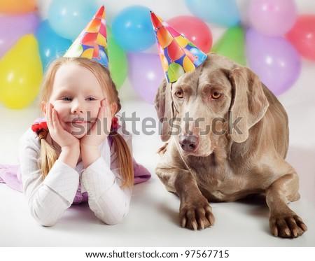 Happy girl and happy dog - stock photo