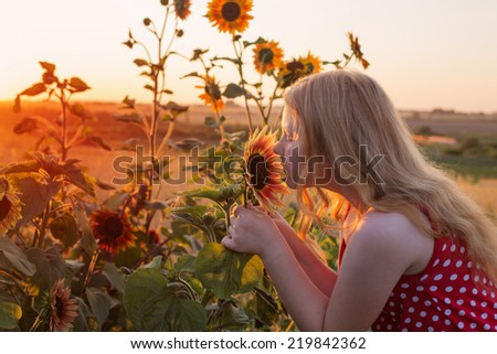 happy girl and sunflower - stock photo