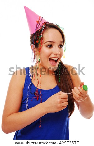 Happy girl celebrating with party popper on isolated white background - stock photo