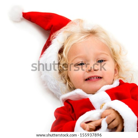 Happy girl dressed as Santa enjoying the Christmas time  - stock photo