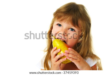 happy girl eating yellow pear; closeup