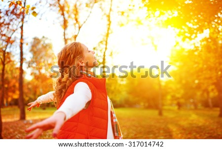 happy girl enjoying life and freedom in the autumn on the nature - stock photo