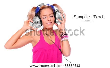 Happy girl enjoys listening music in headphones on a white background. Picture with space for your text.