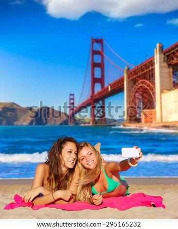 happy girl friends selfie portrait beach sand in San Francisco photo mount - stock photo