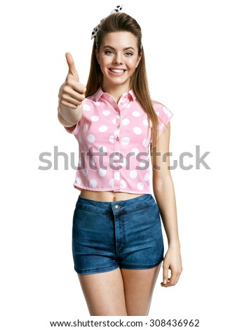 Happy girl gesturing thumb up sign. Good for you / photo of young cheerful brunette woman over white background, positive emotions - stock photo
