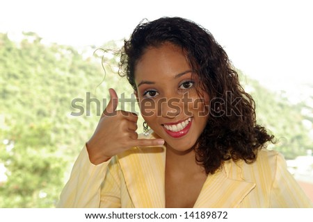 happy girl giving the please call me sign - stock photo