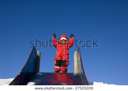 happy girl going to go down the slide - stock photo
